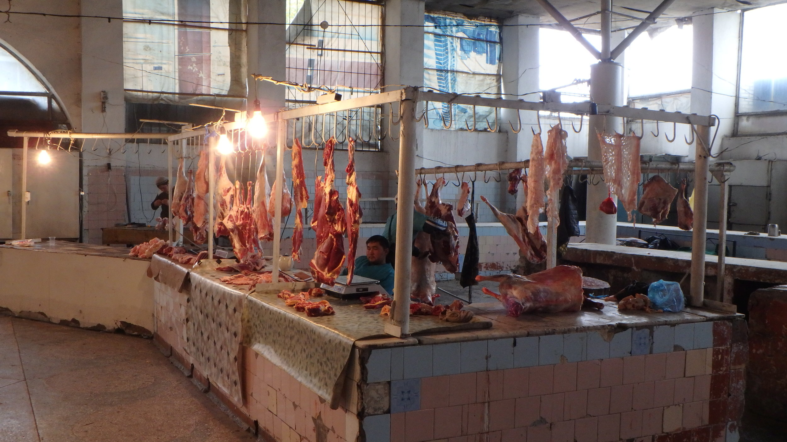 Meat dude, waiting for some business, Osh bazaar.