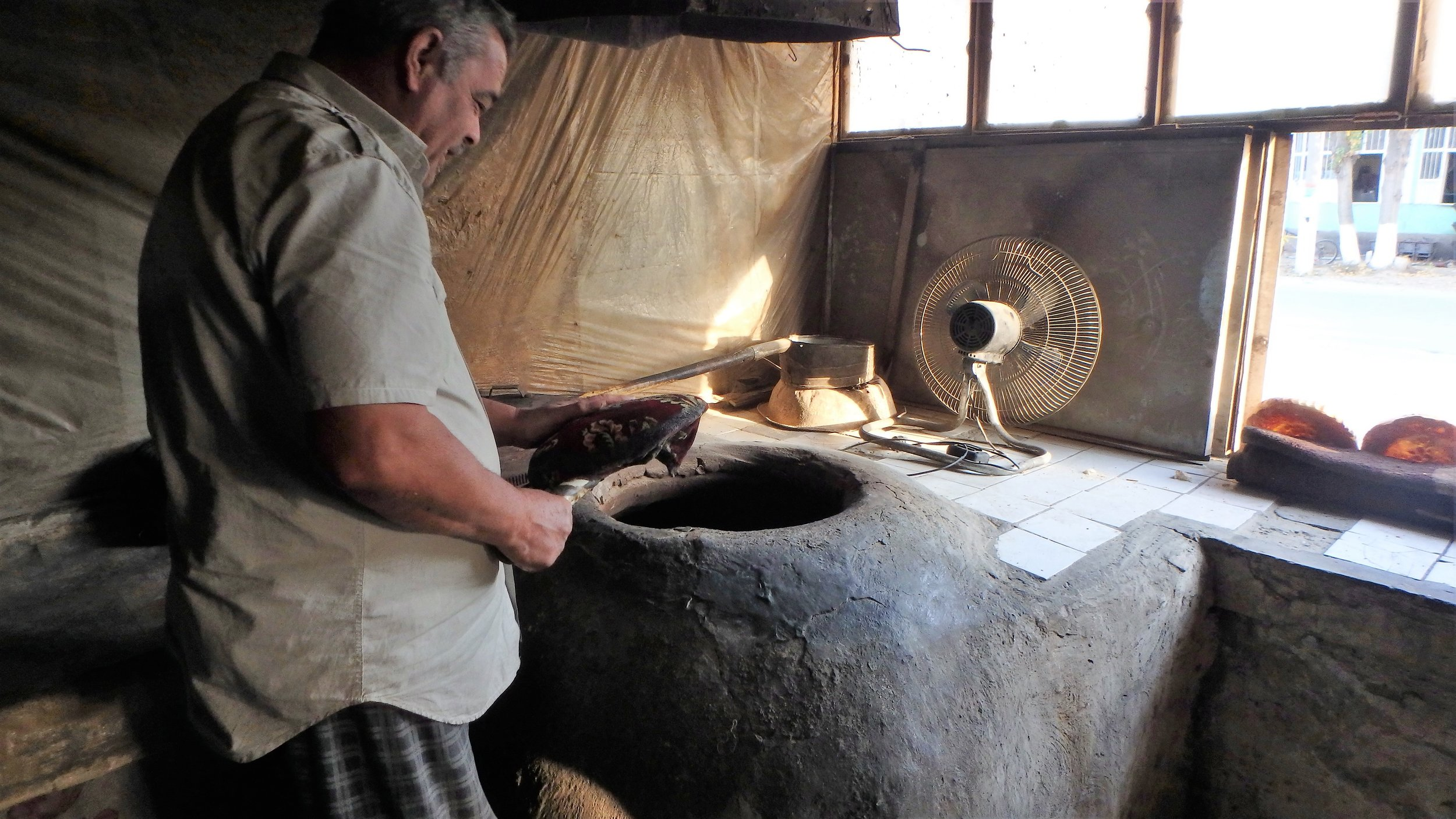 An baker in Istaravshan with his big oven.