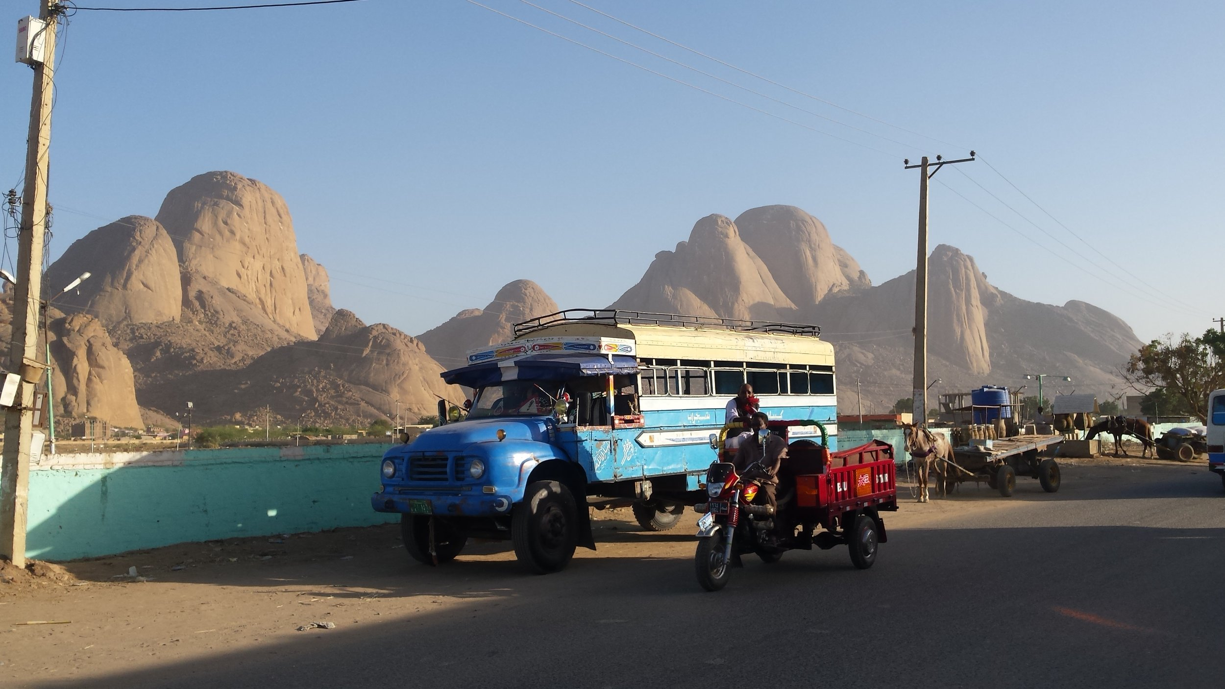 From the Red Sea coast we traveled to Kassala, where the distinctive Taka Mountains loom over the city…