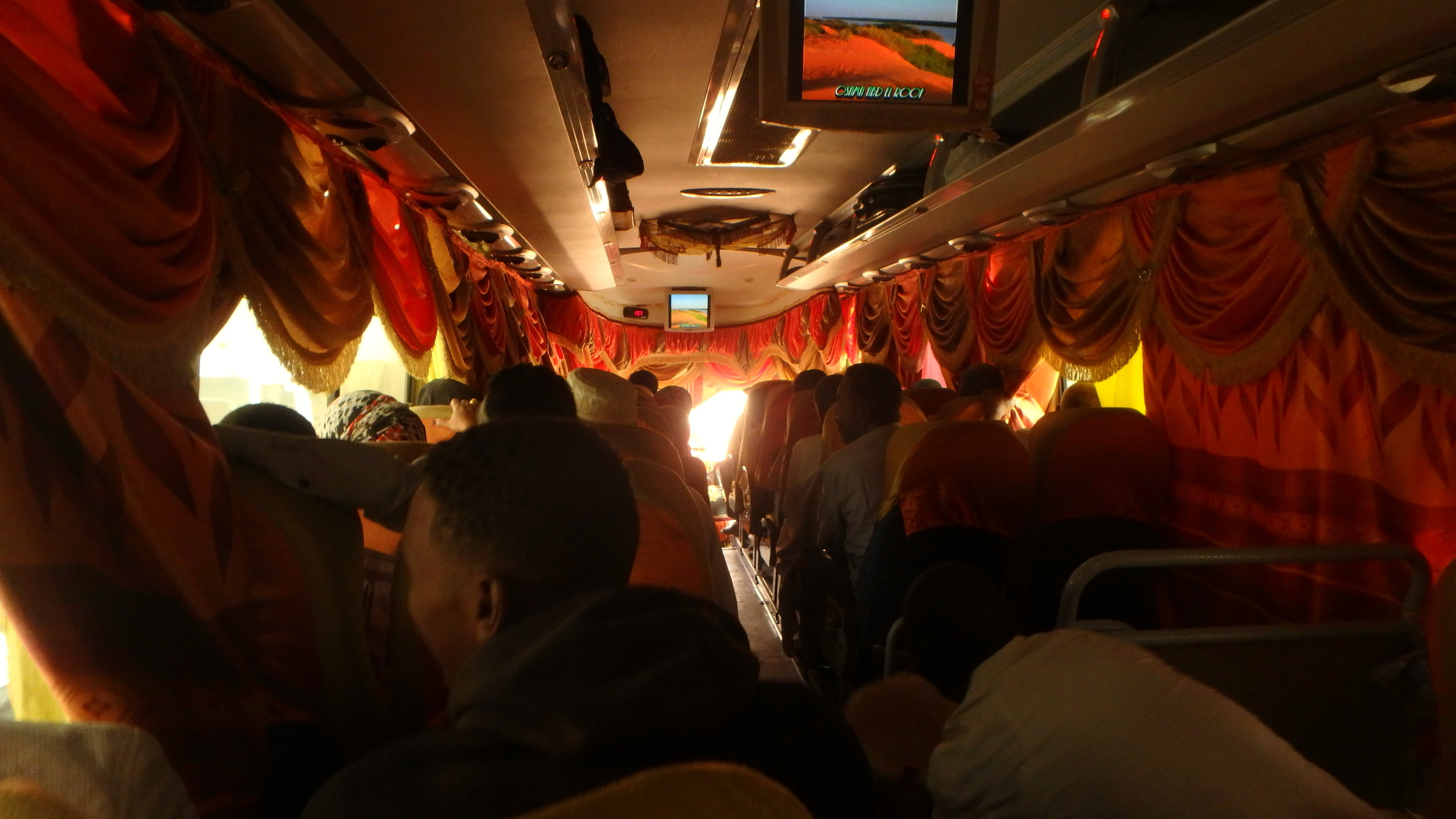 A typical scene on a Sudanese long distance bus, where keeping cool is the name of the game.