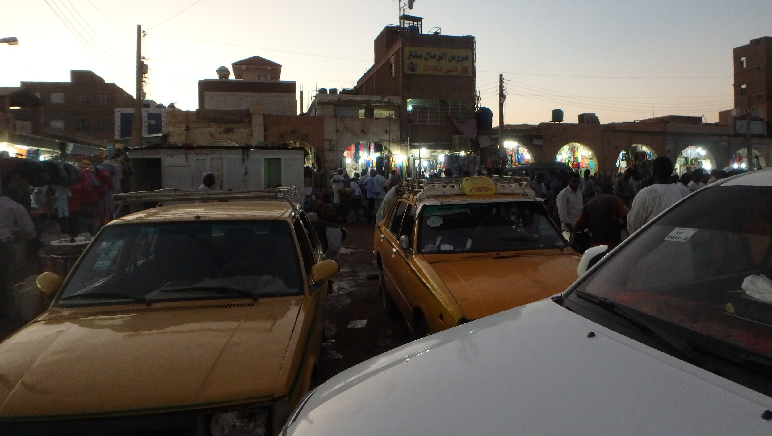 Welcome to Khartoum, thriving and throbbing hub of Sudan.   Parking lot at the entrance to Souq Omdurman, one of the largest bazaars in northern Africa.