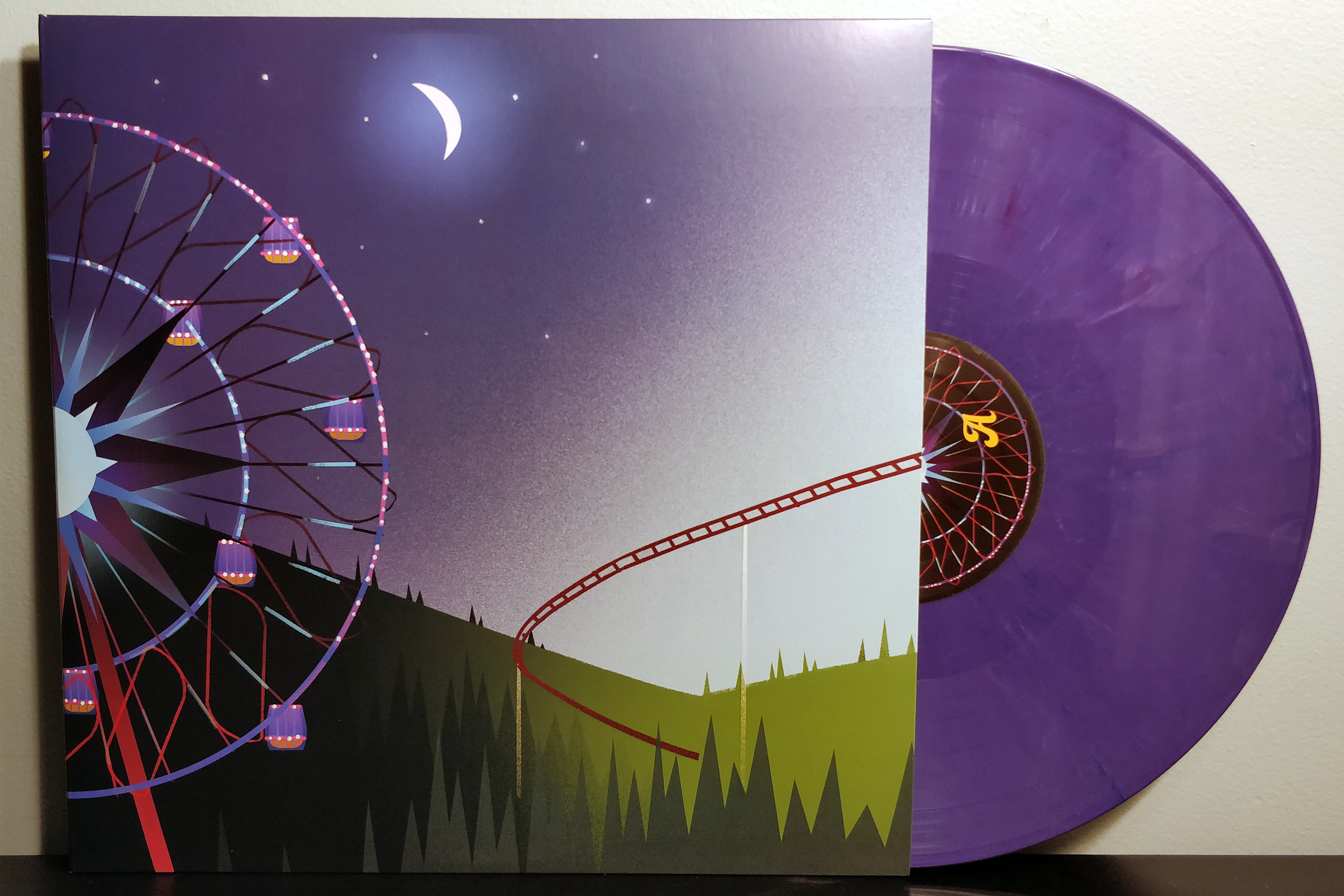 "You, Me & Gravity: The Music of Planet Coaster by Jim Guthrie & JJ Ipsen pressed on ""Day Turns to Night"" vinyl by iam8bit"