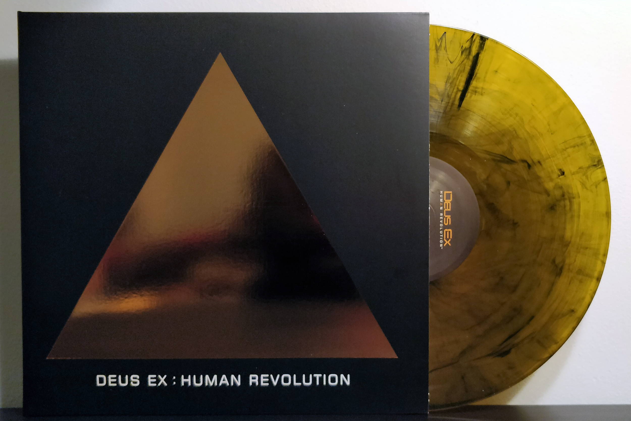 "Deus Ex: Human Revolution by Michael McCann pressed on ""Golden Smog"" vinyl by Sumthing Else Music Works"