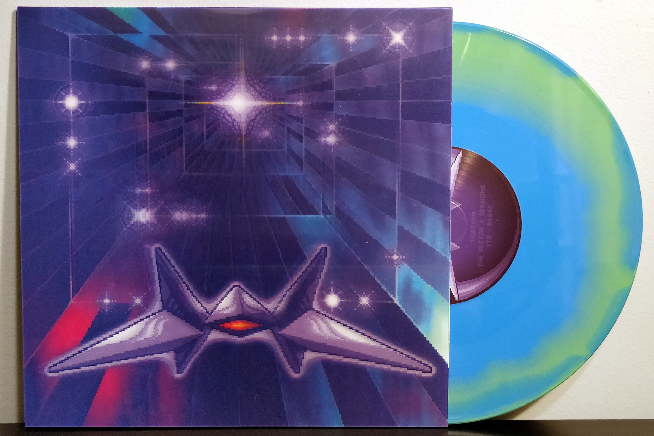 "Fortuna: The Sector X Sessions by Yetee Records & Materia Collective pressed on ""Corneria Planet"" blue and green swirl vinyl."