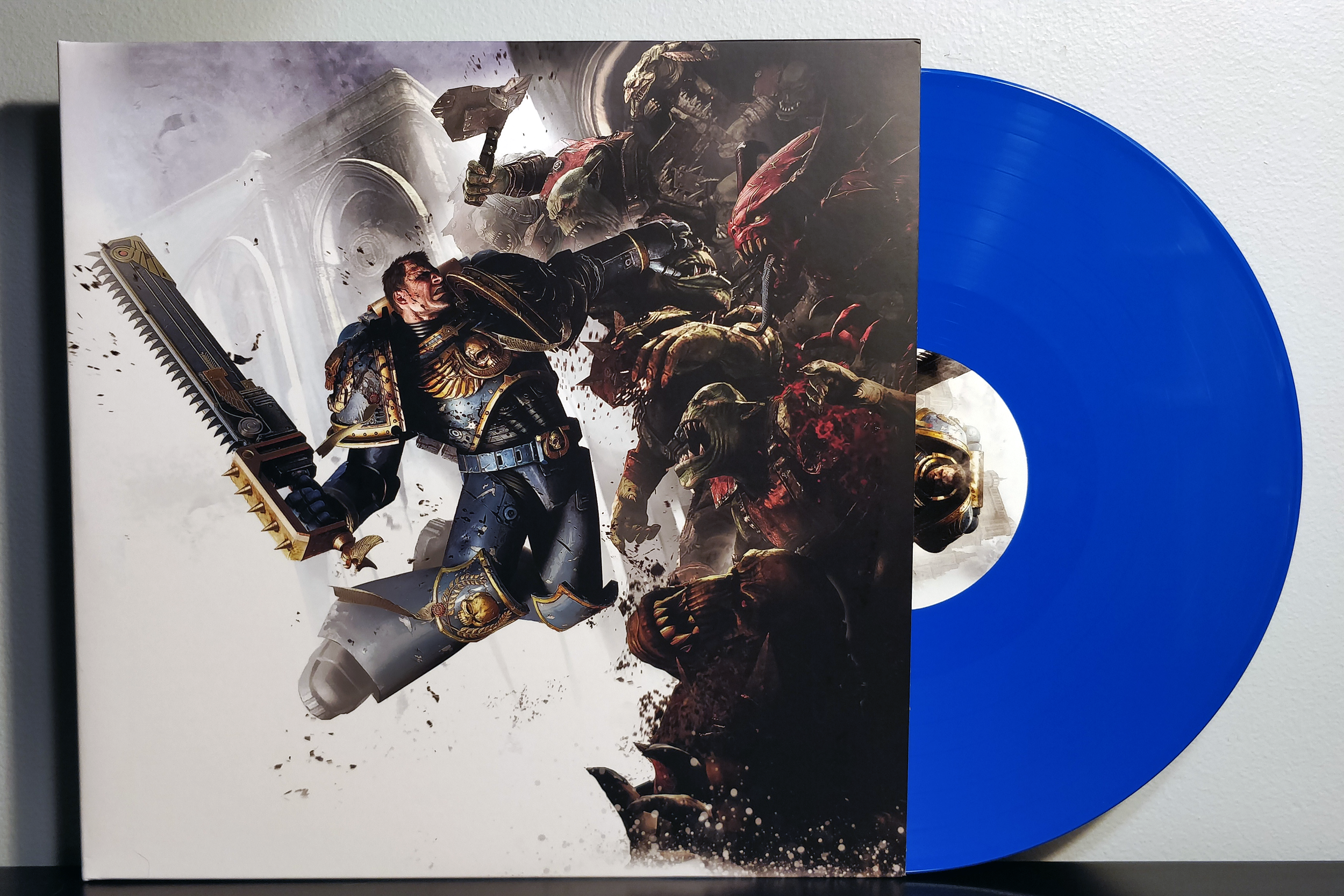 Warhammer 40,000: Space Marine by Cris Velasco & Sascha Dikiciyan pressed on blue and white vinyl by Laced Records