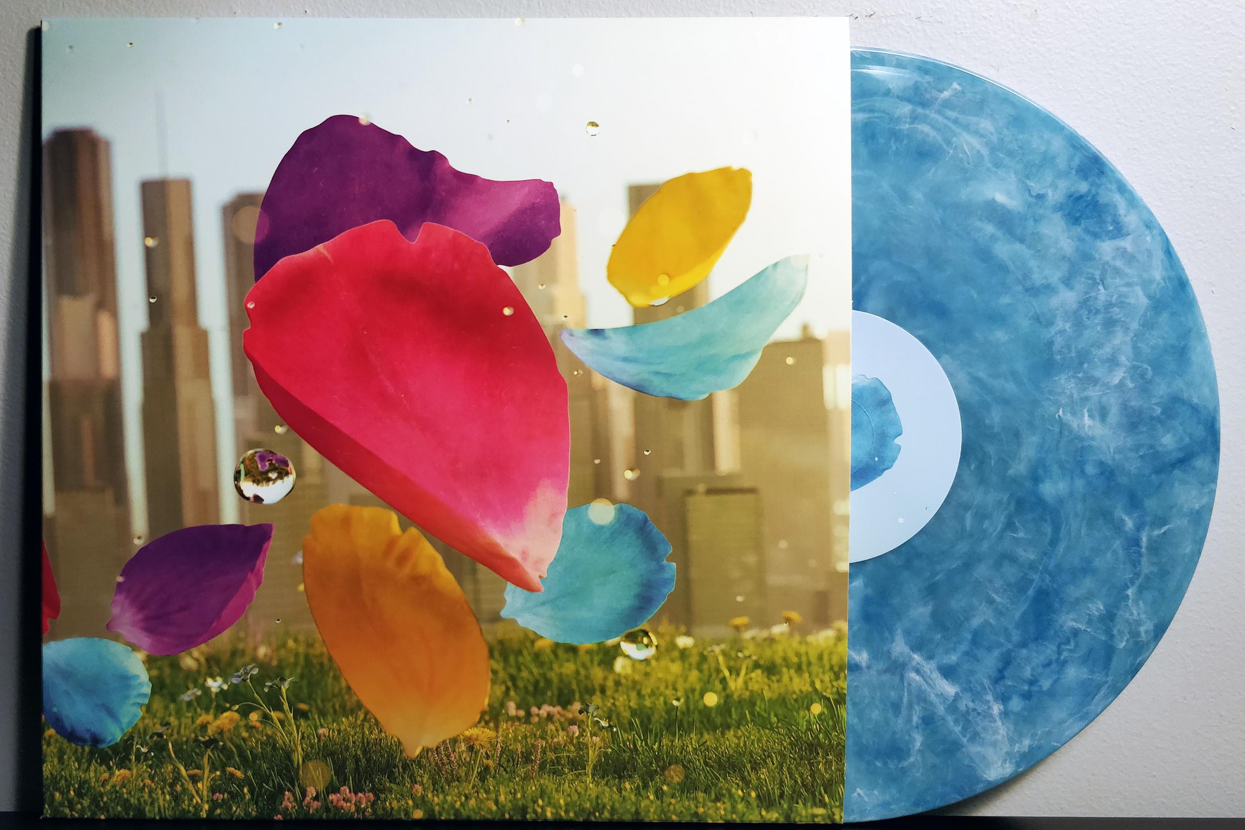 Flower  by Vincent Diamante pressed on blue marble & white with blue vinyl by iam8bit