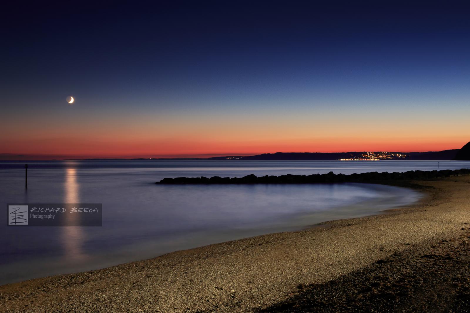 Moon Over West Bay Beach