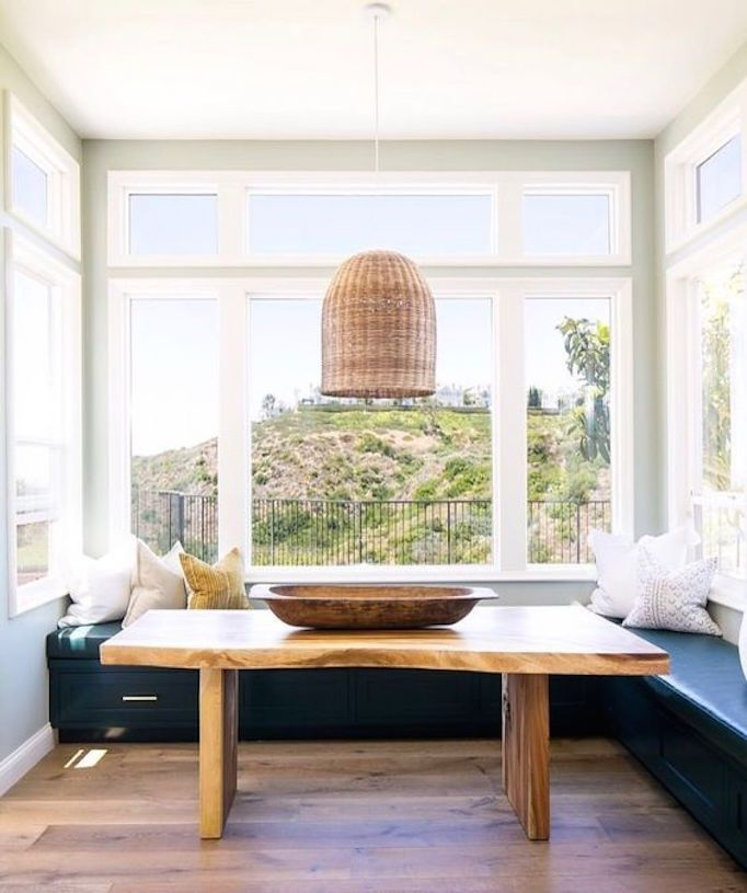 Love the organic live wood edge table in this lovely dining nook designed by  Willa Ford Interiors