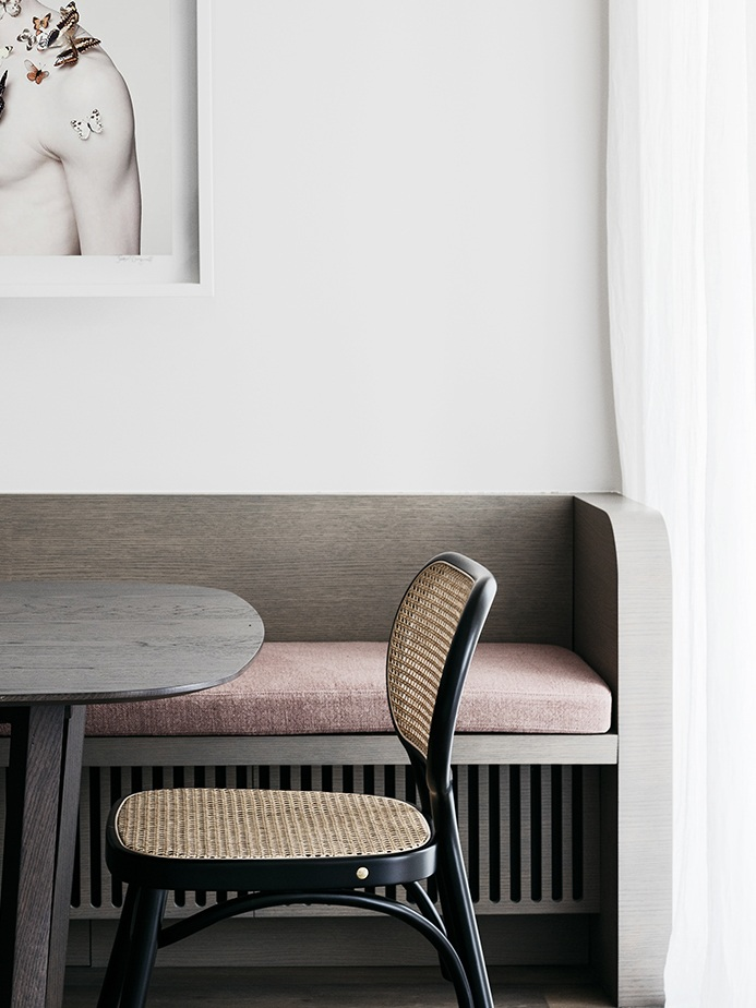 Designed by the Australia firm  Decus Interiors , this bench is beautifully detailed, the warm accent wood color and blush cushion make it feel so inviting.