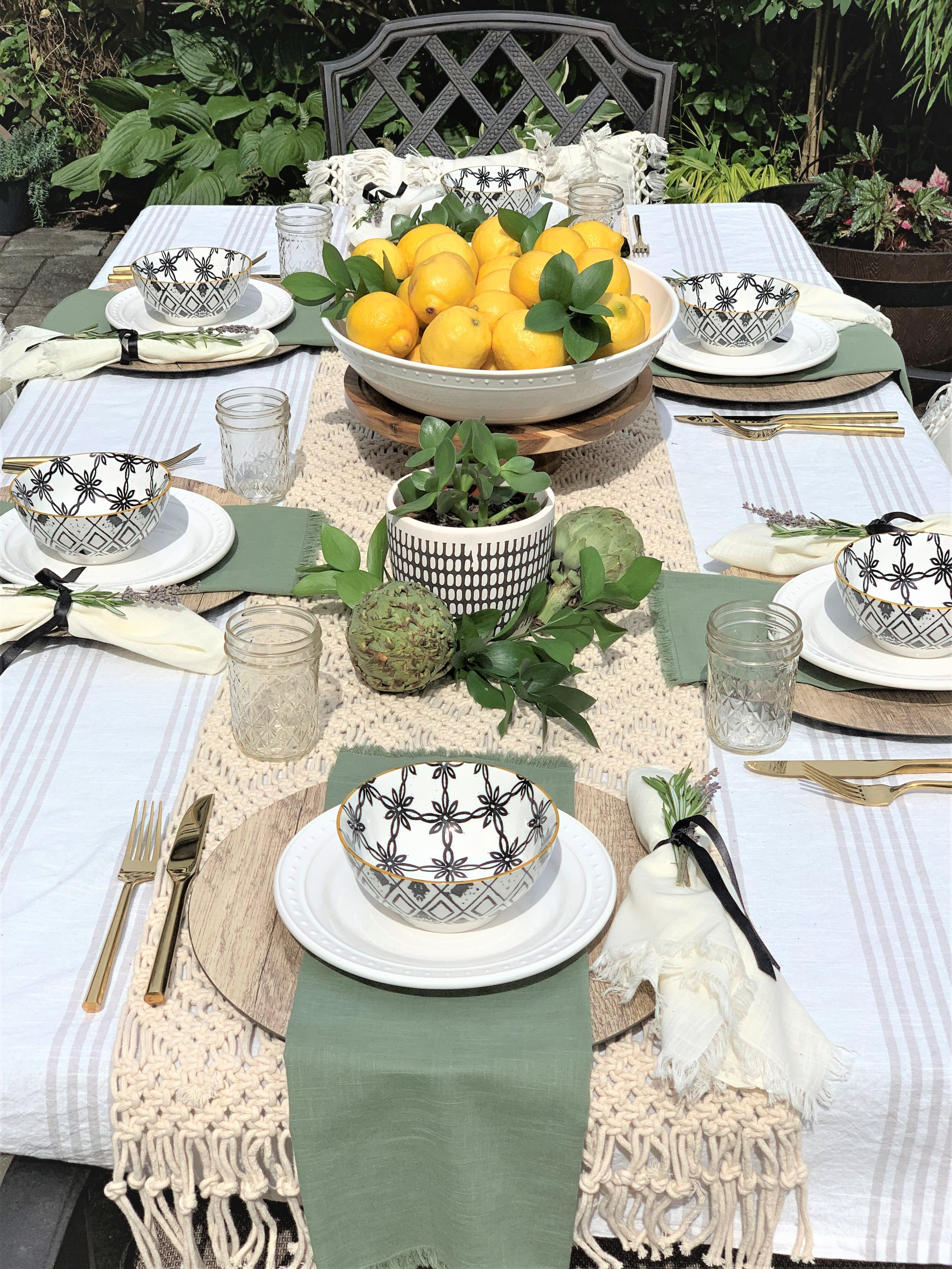 Tablescape by beam&bloom, World Market  White Plates ,  serving bowl ,  cloth napkins  and  macrame table runner . Target  flatware  and  tablecloth .  At Home  chargers and bowls.