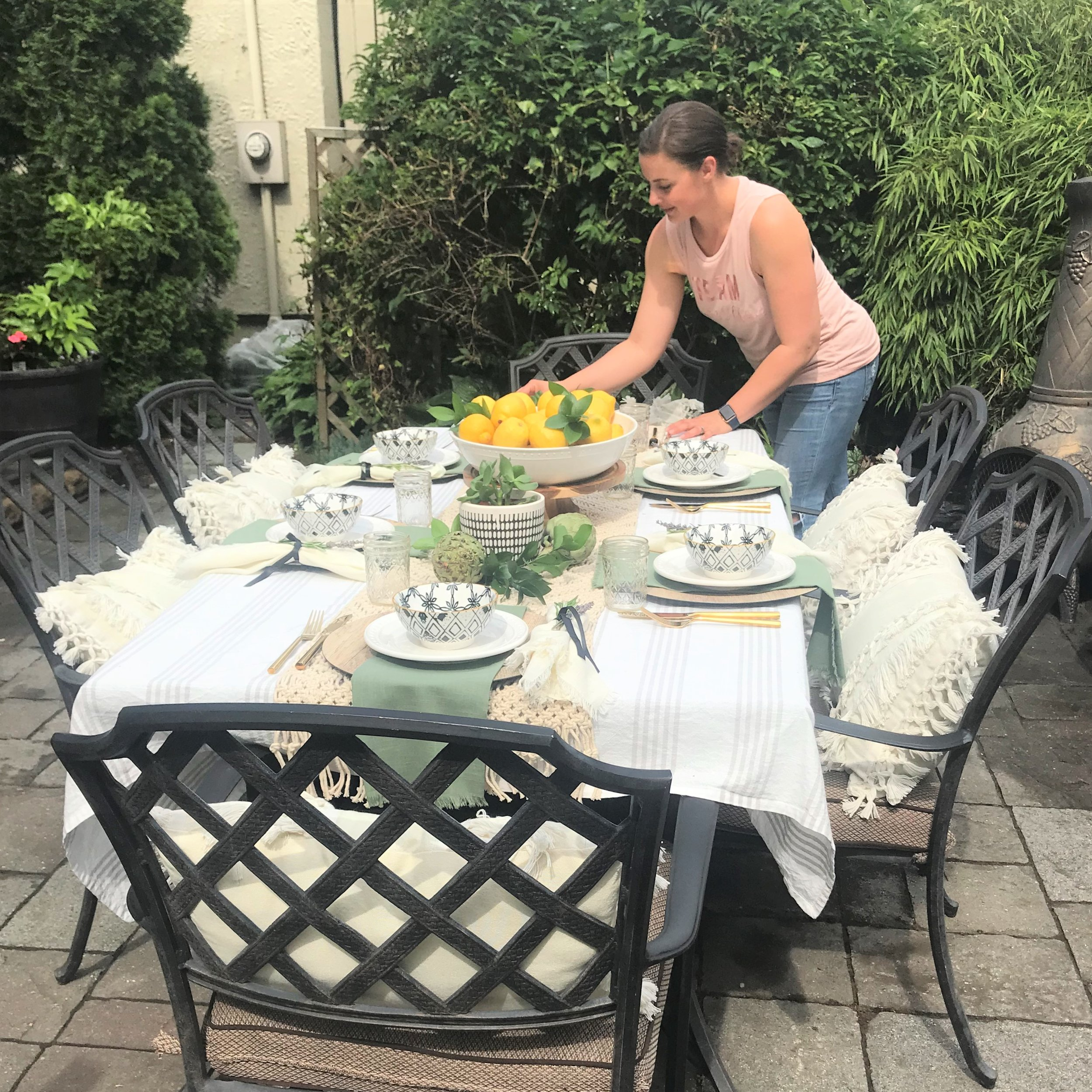 Owner/Designer, Noel Gatts, setting her table design