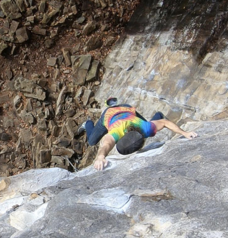"Cutting feet above the void on ""Bottled Up Warrior (5.12b)"""