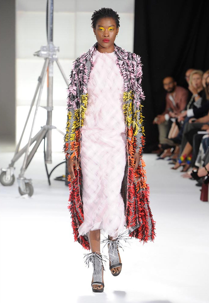 PINK ORGANZA WOVEN BACKLESS DRESS WORN WITH HAND WOVEN SUNSET CLENCH COAT