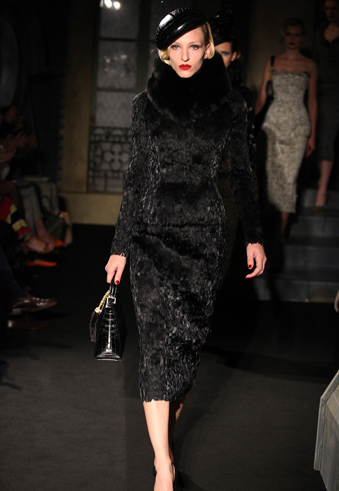Black feather corset dress, fitted black feather jacket with fox fur collar, black crocodile hat, black crocodile bag and black crocodile shoes