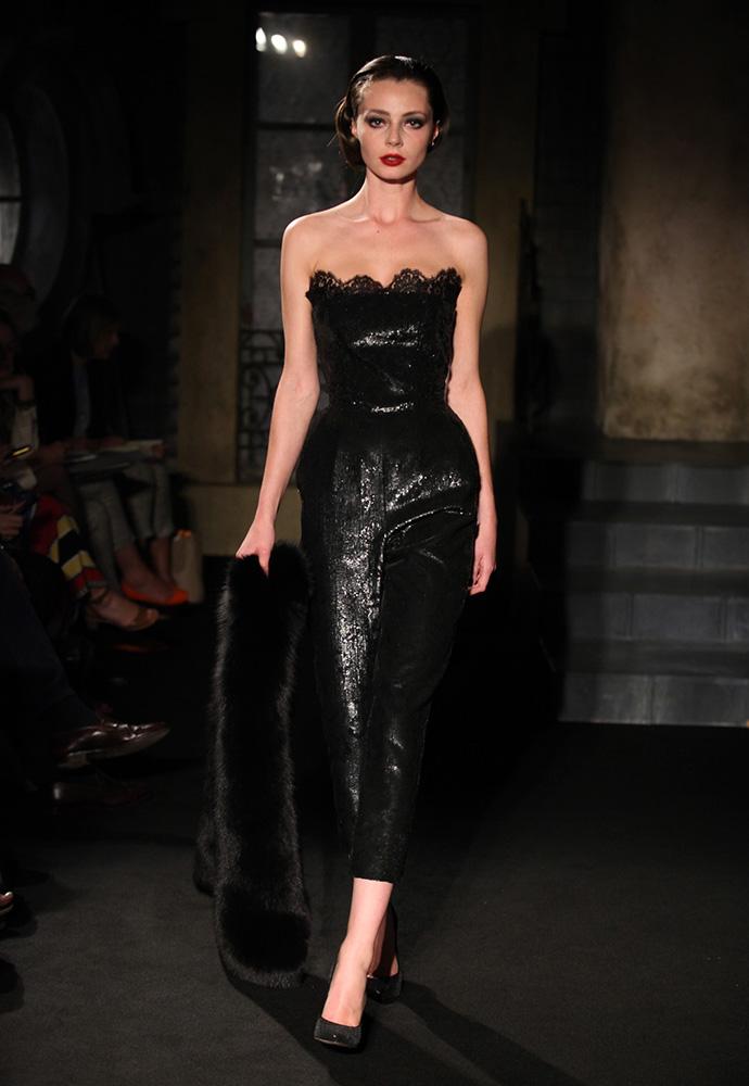 Black on black sequinned leopard jumpsuit, black fox fur stole and black sequinned shoes