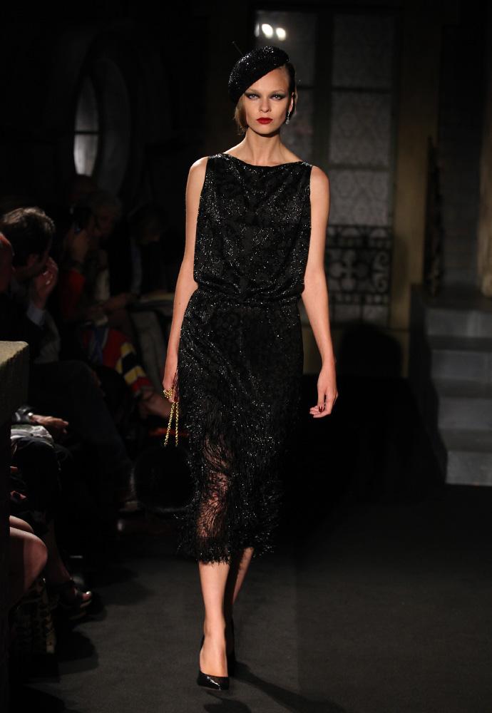 Black on black fringe dress, black sequinned hat, fox fur bag and black lurex velvet shoes