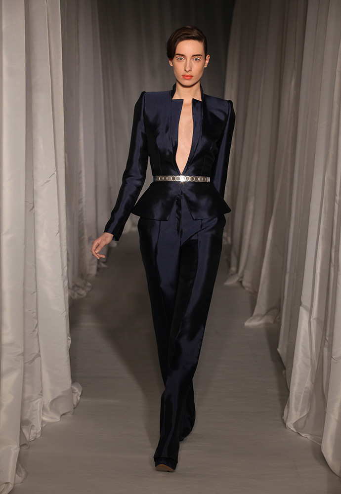 Midnight blue satin peplum trouser suit with slim silver hexagon belt