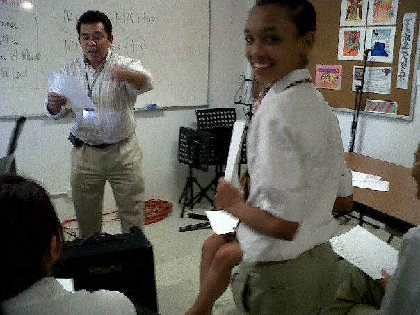 A blurry picture of me in music class.