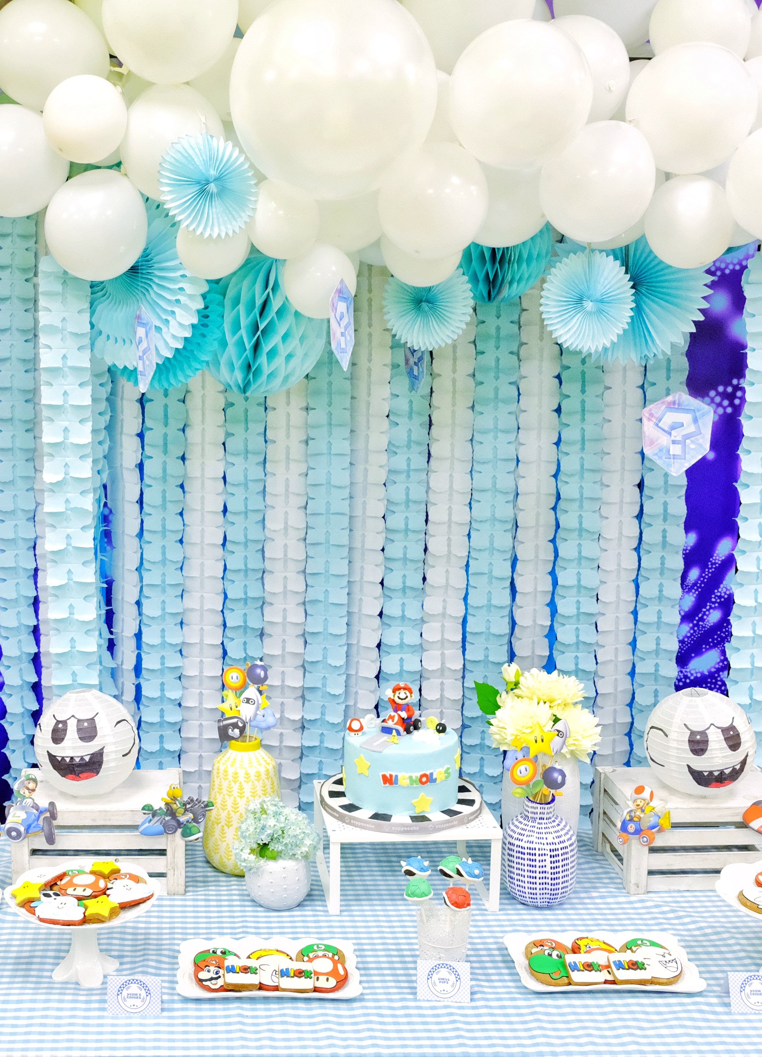 A Modern Mario Kart - We anchored this party on white and sky blue to make it more modern and seamless, while keeping the bursts of colors alive with the die cut characters, cookies and accents. We wanted this party to appeal to the young and young at heart.