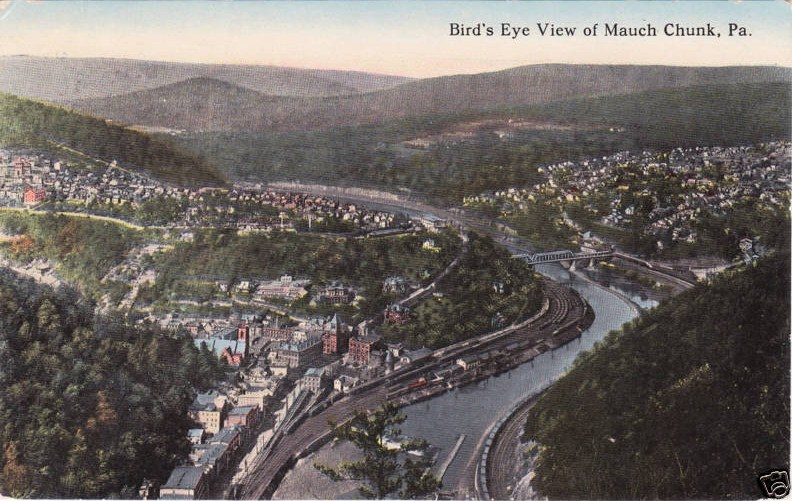 """Mauch Chunk - Photo Credit: Not known; along left-hand side of address side of postcard: """"Published by Tosh's Department Store of Mauch Chunk, PA Made in U.S.A."""" [Public domain], via Wikimedia Commons"""