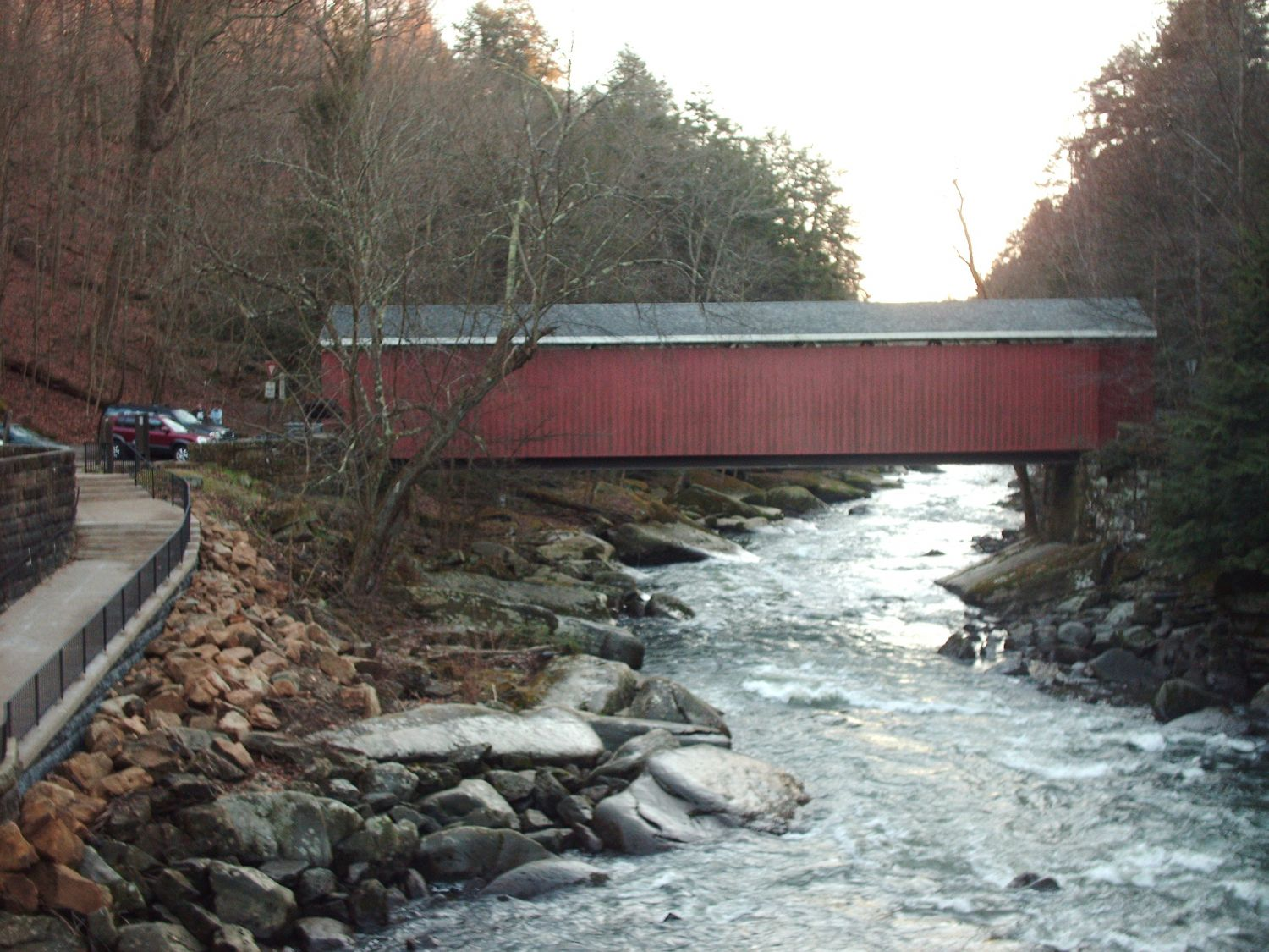 View of the covered bridge in McConnells Mill State Park from a walkway near the mill itself - Photo Credit: Nyttend [Public domain], from Wikimedia Commons