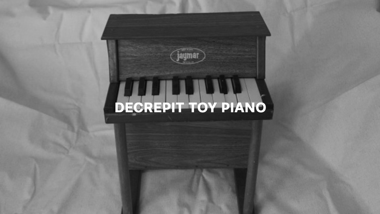 Decrepit Toy Piano Text.jpg