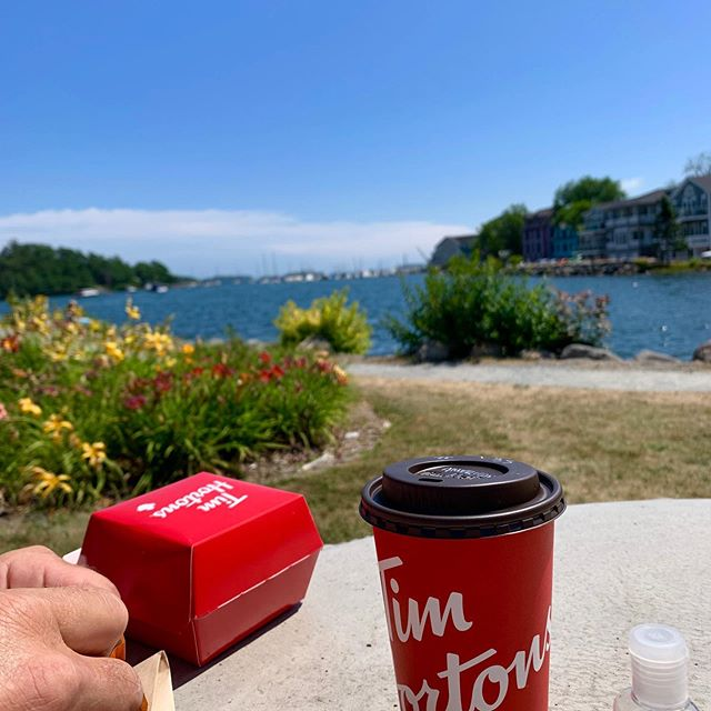 Typical Canadian break. Tim's coffee, while enjoying the scenery of the beautiful East coast....We WILL NOT be at the farmers market this Saturday. We are enjoying Halifax & surrounding area. See you August 17th. #eastcostcanada #welovecanada #travellingvegans #dwfm #plantbased