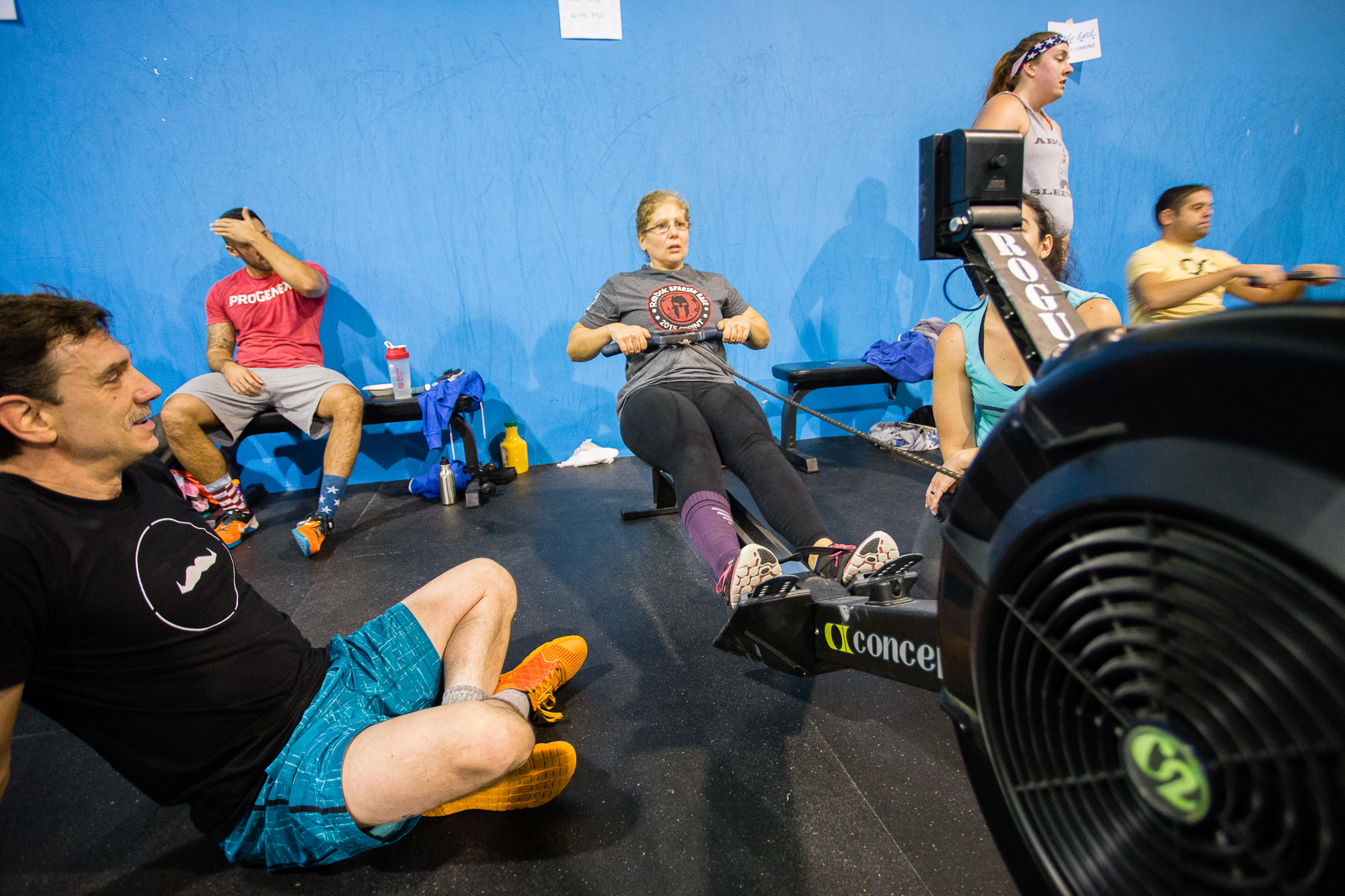 Paola, visibly thrilled to be rowing for her team in the CrossFit Aevitas Movember Row-a-thon event