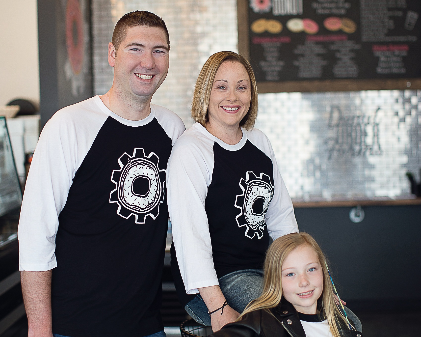 "ABOUT US - We are Industrial Donut, a family owned and operated donut (and coffee) shop in Savoy, IL. Our family team consists of James, Becca, and Sydney (mini-owner), all born and bred in central IL. Foodies to the core, we've spent the last 7 years traveling, trying unique restaurants and experiencing new food concepts. Continually saying, ""we need something like this back home"", we finally decided that the time had come to bring FRESH, made-to-order DONUTS to Chambanavoy!"