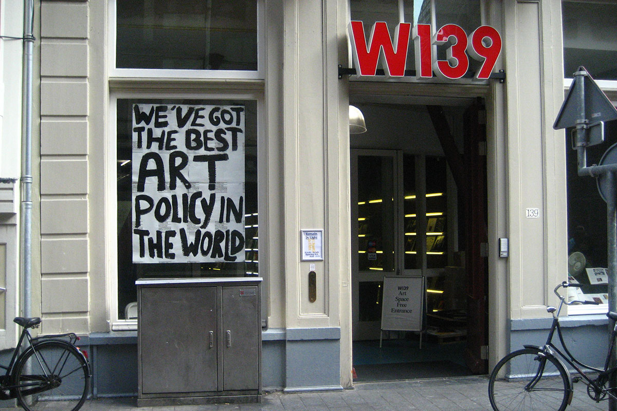W139, facade with banners of Temporary Museum Amsterdam