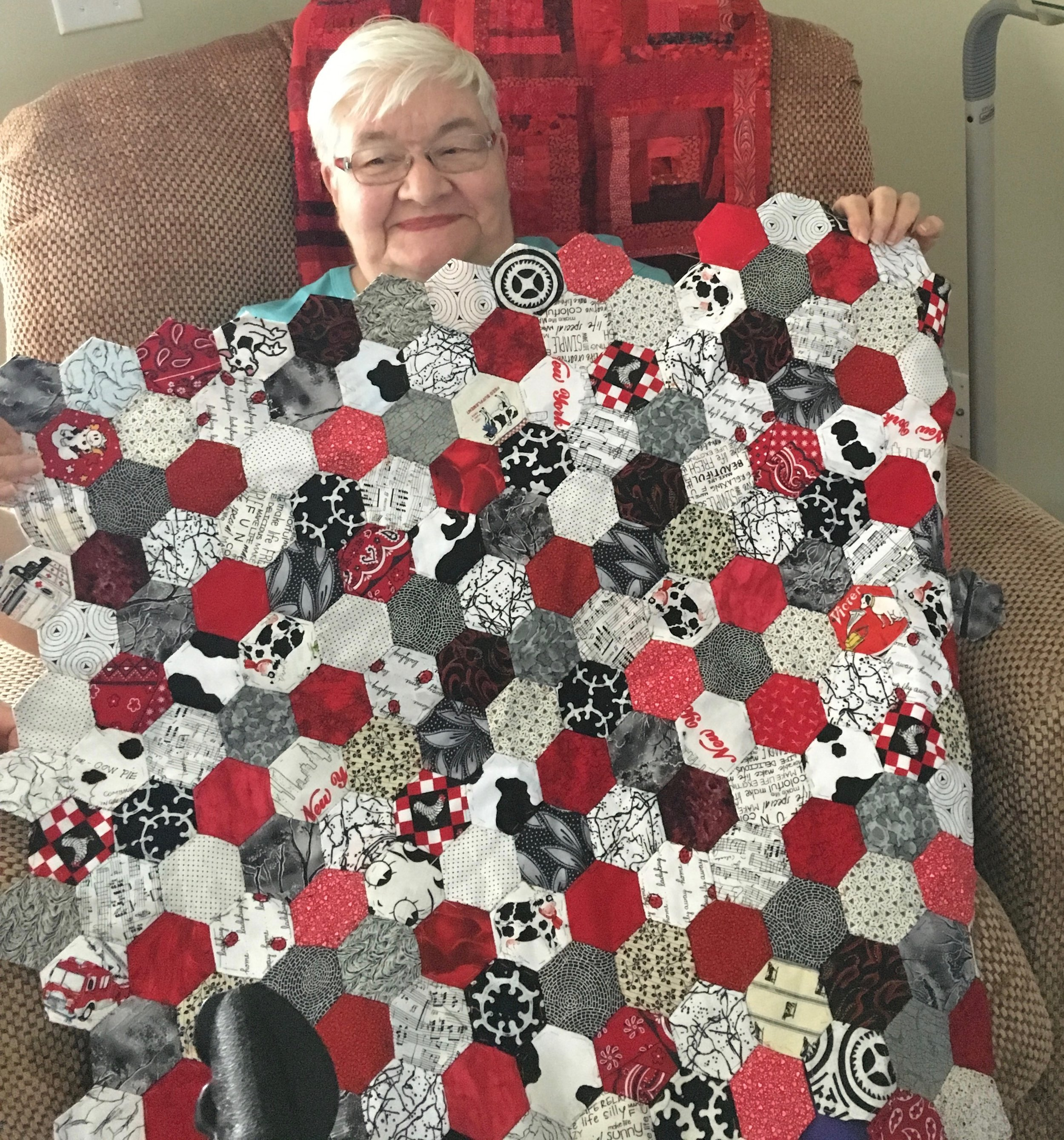 We have lost track of how many hexagon quilts Mary has made but she is hot on another one. She is amazing and will always go down in my history book as the creative lady who named my  Grid Grip.