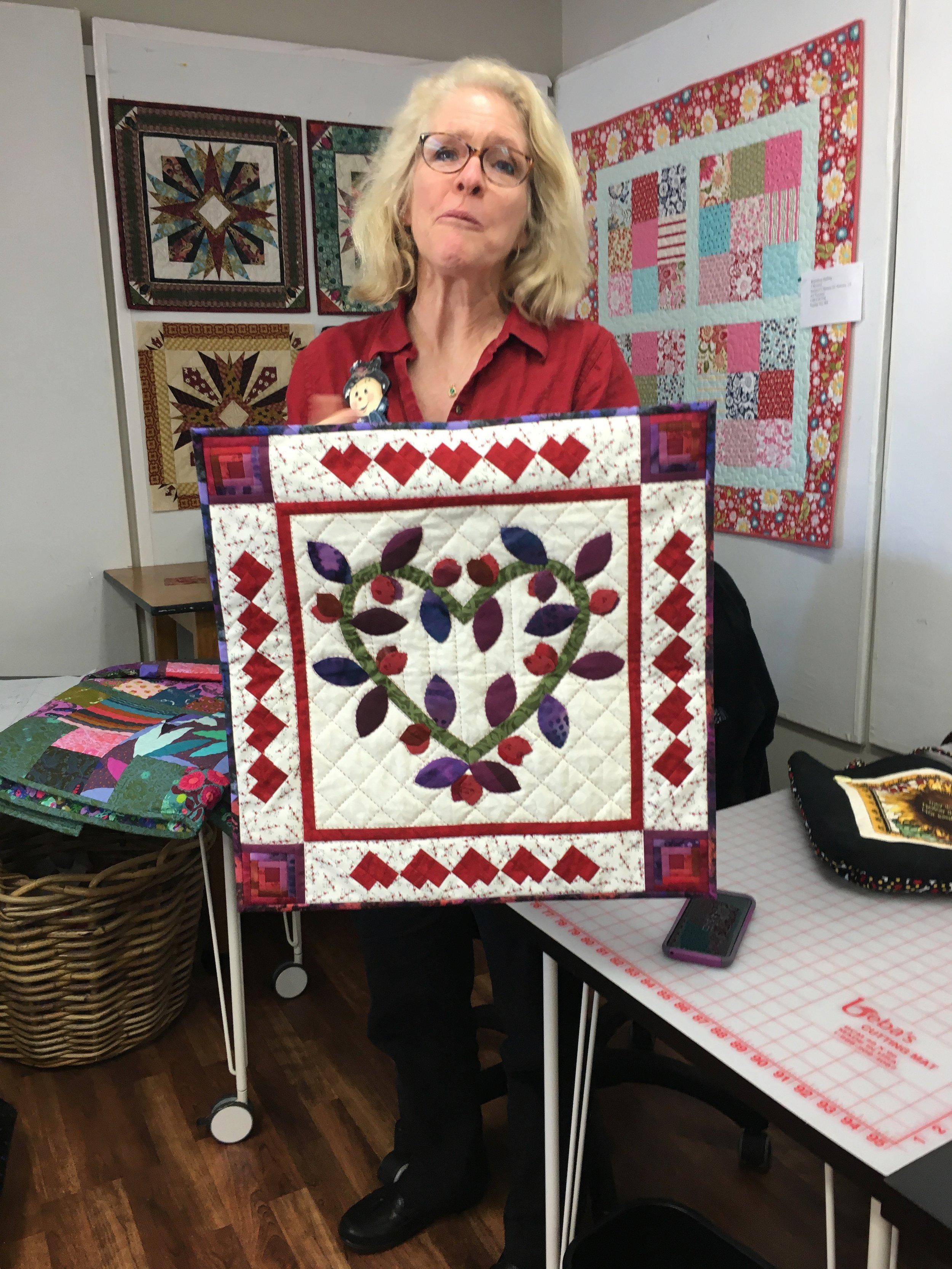 Deb presented her February block. Those border hearts are pieced in that seminole fashion of piece and re piece. Just Great!