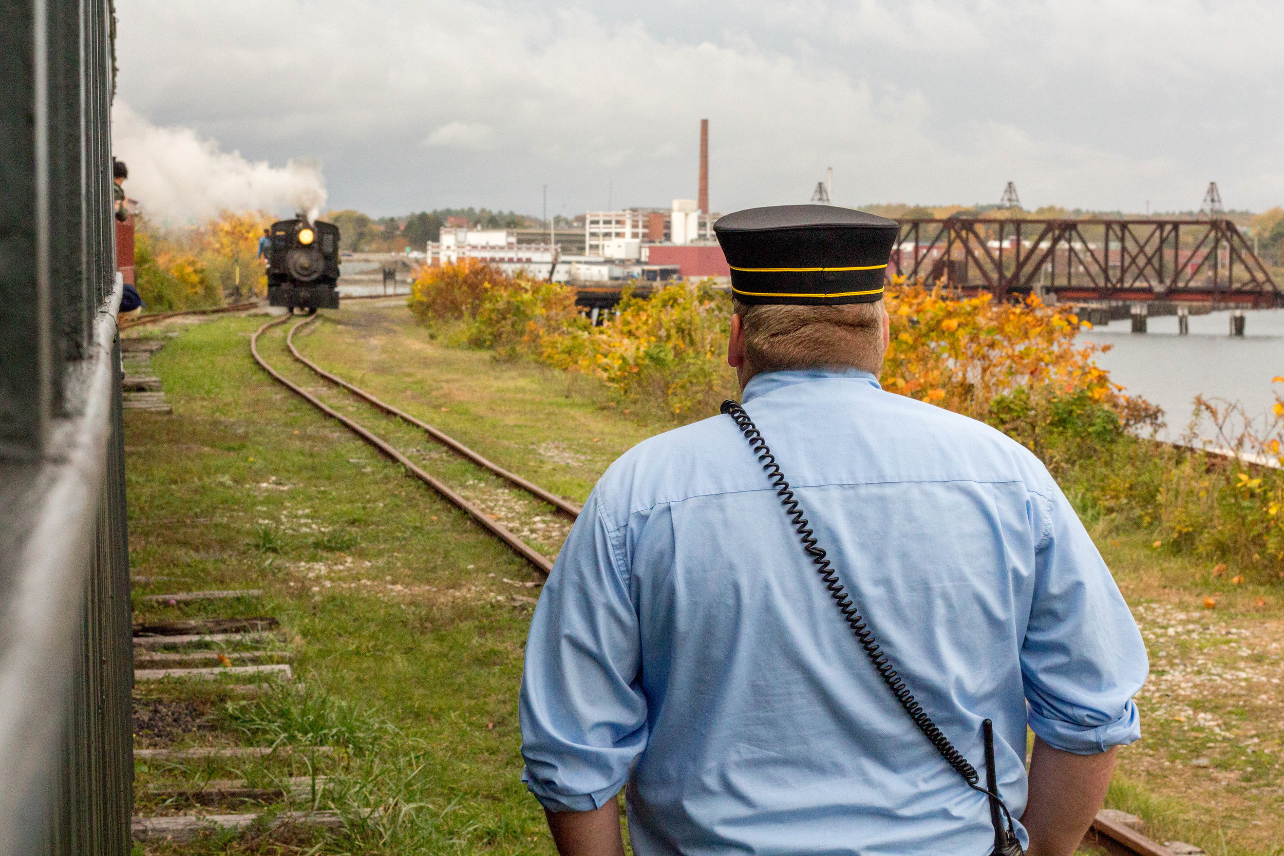 Passengers and Volunteers take the last ride of the 2017 season on the Maine Narrow Gauge Railroad's train in Portland, Maine on October 29, 2017.