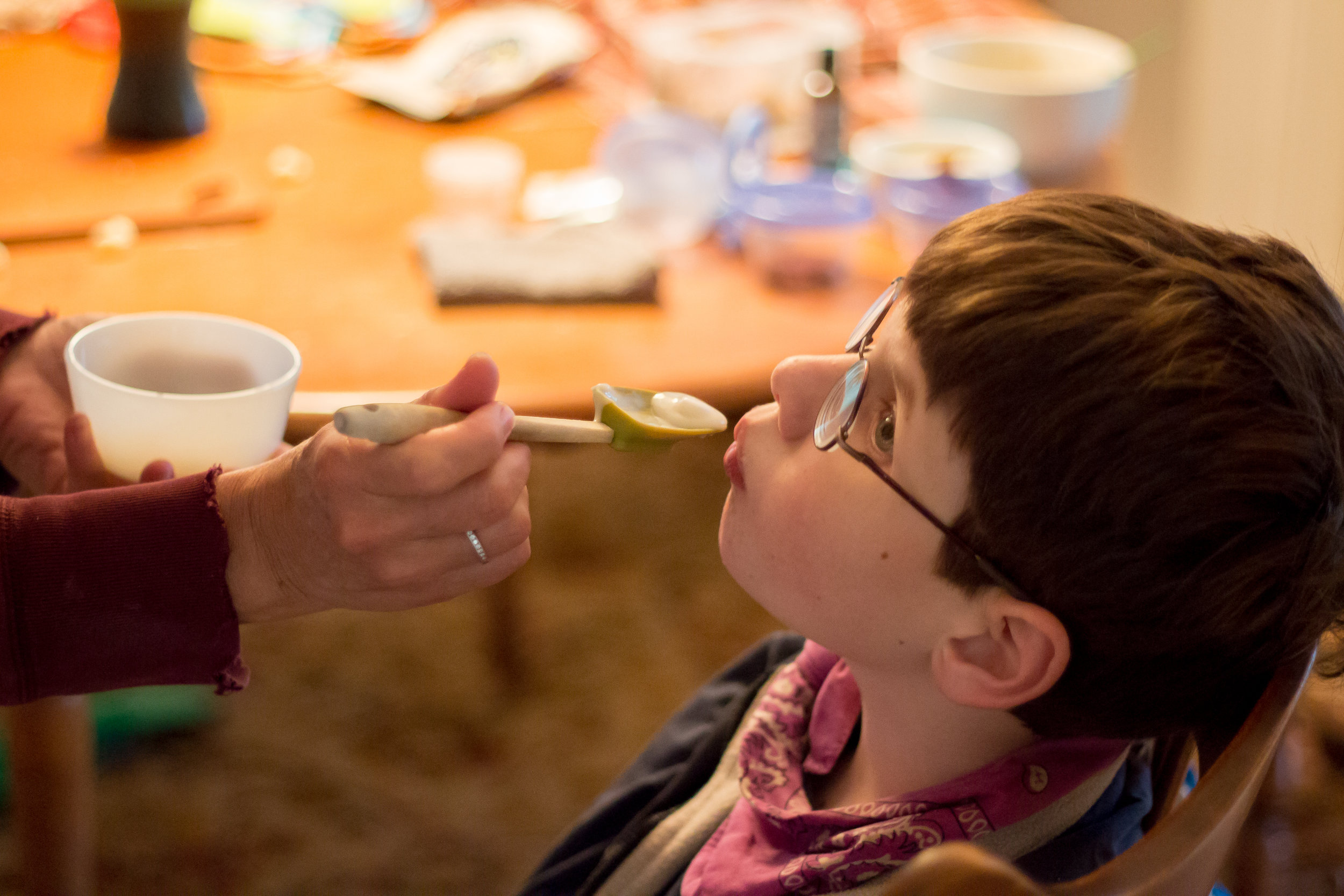 Christy Shake feeds her son Calvin his afternoon dose of cannabis oil mixed with yogurt on October 8, 2017. Christy purchases the cannabis and then takes the plant matter through a lengthy process to create a resin which she then suspends in oil. She feels the cannabis does have some effect on the seizures, but its real benefit is curbing the severe side-effects of the benzodiazepine withdrawal.