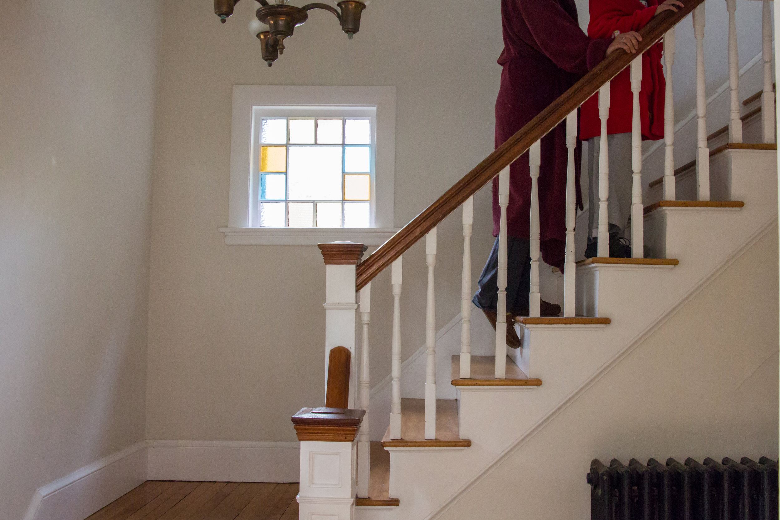 Christy Shake walks behind her son Calvin up the stairs in their home in Brunswick, Maine on September 30, 2017. Though Calvin can walk on his own now, his balance and vision are not good, and he can easily fall without Christy nearby to catch him. Much of their routine when he is home consists of her following him from room to room.