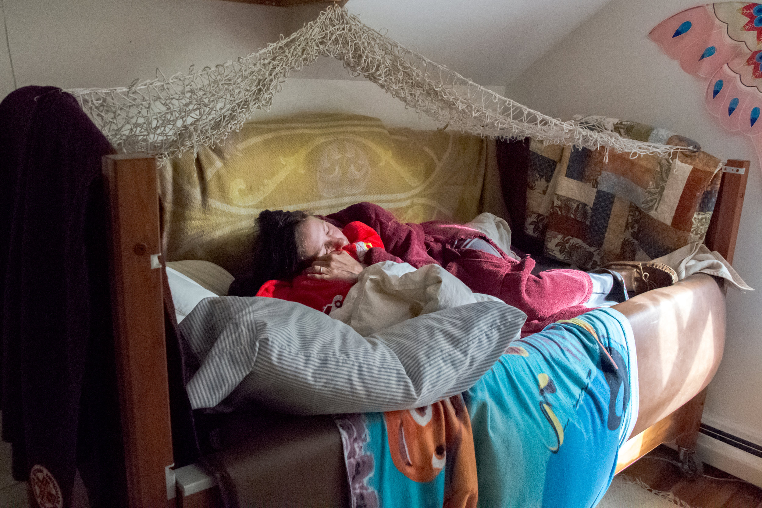 Christy Shake cuddles her son Calvin in his bed a few hours after he has had a grand mal seizure on September 30, 2017 in Brunswick, Maine. Though his number of daytime seizures has decreased dramatically since she began treating him with cannabis, he still has grand mal seizures in the early morning hours almost weekly.