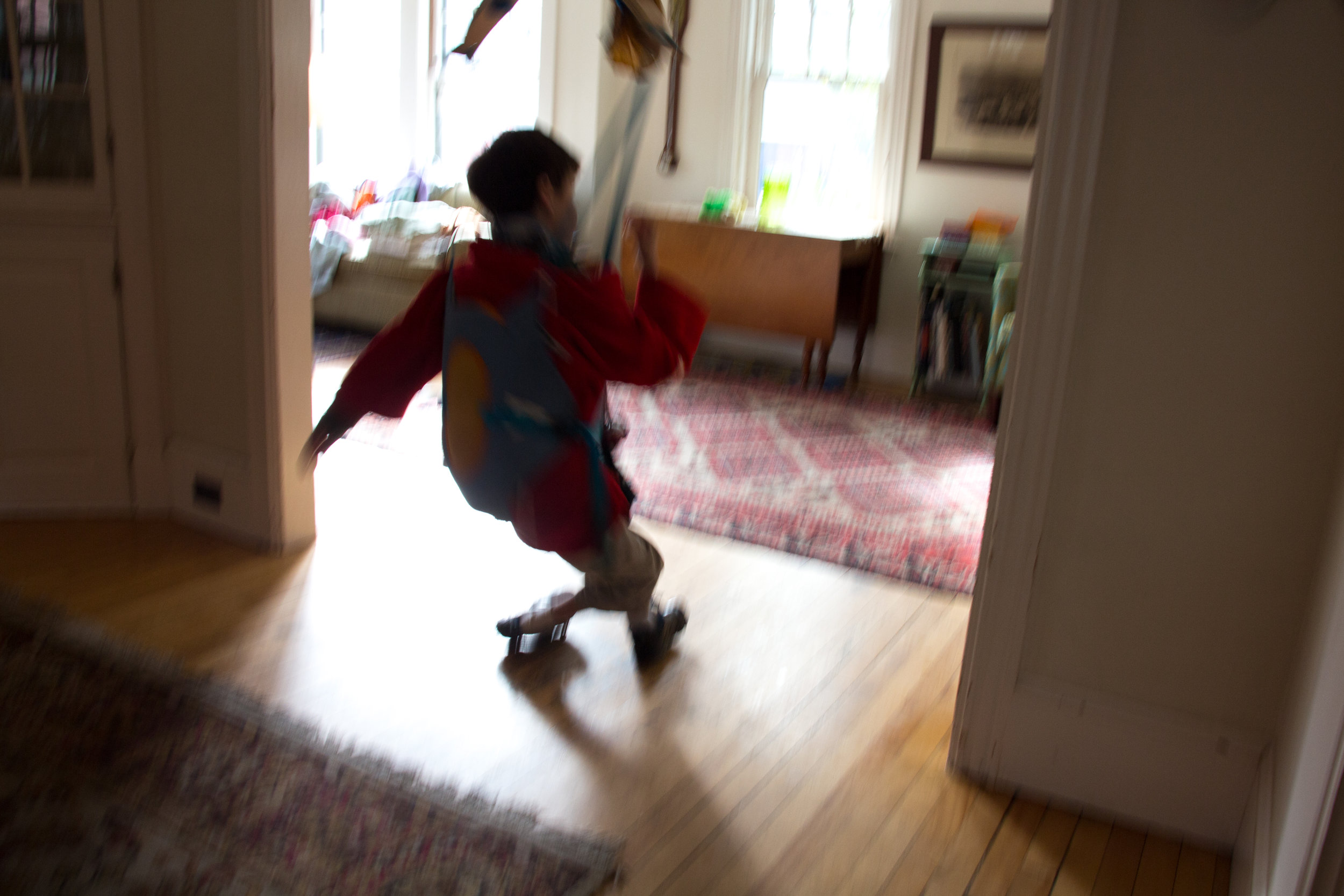 "Calvin Kolster of Brunswick, Maine enjoys spinning himself in circles in his jumper that hangs from the dining room doorway of his house on September 29, 2017.  When Calvin was a baby, the doctors said he likely wouldn't walk, talk, or crawl. At eighteen months he said ""momma"" for the first time. Not long after, he had his first seizure and never said another word. At two years old, he was diagnosed with severe epilepsy. At three years old he was prescribed his first valium. Now, at thirteen, he is in an active benzodiazepine withdrawal, the symptoms of which are treated with cannabis."