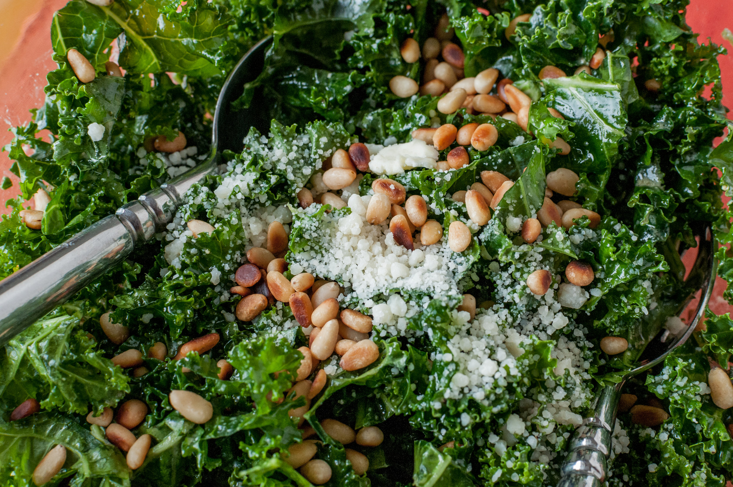 Kale salad with cannabis-infused dressing, pine nuts and pecorino cheese