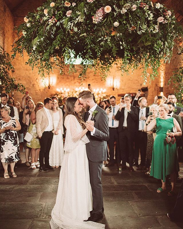A first dance under the most amazing floral foliage 😍💖 . Lauren wearing our Olwen gown from @haloandwrenbridal shot by @lemonadepictures with florals from @go_wild_flowers 💖
