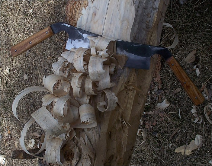 Shaping logs. Drawing feathers with a draw knife, 10 inch edge.
