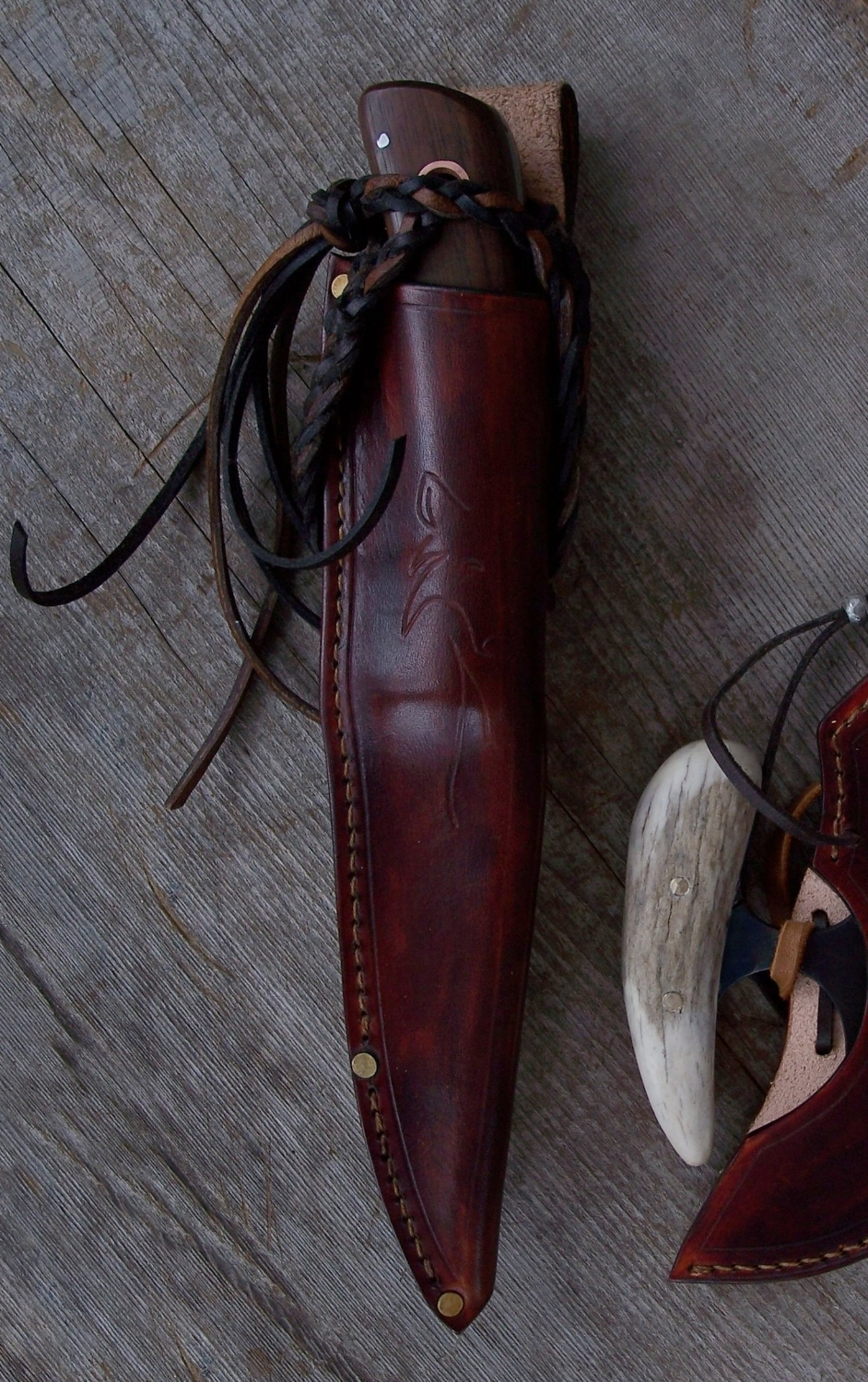 Long locking lanyard for knife security on the Kootenay hunting knife sheath.