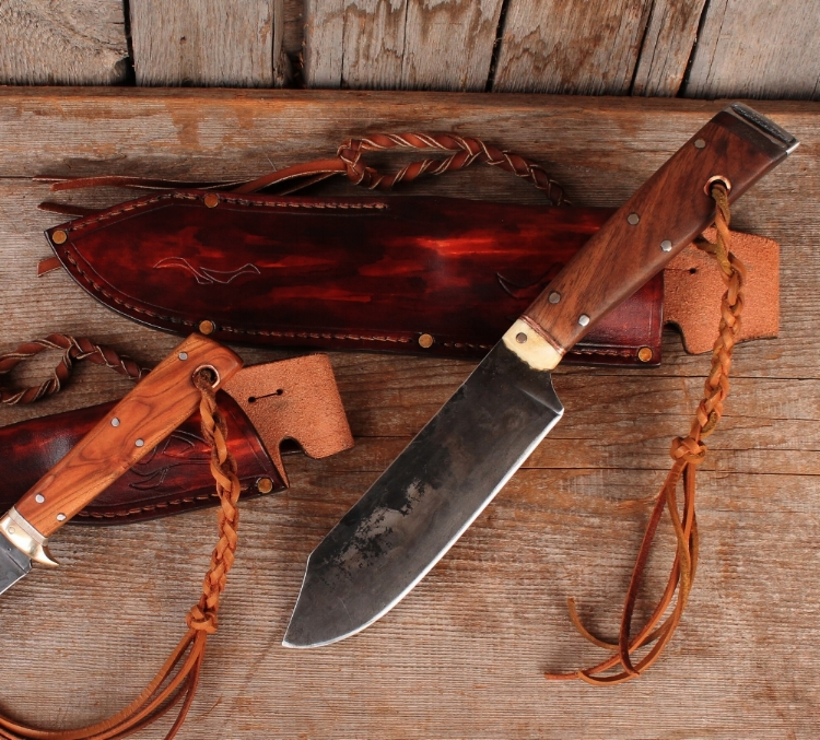 Hand forged bushcraft knives. Custom bush craft sheaths.