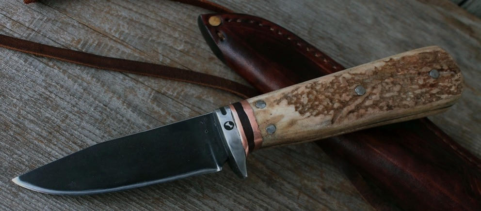 Custom made woodcarving knife. This  Kirsten carving knife  was custom made for a wood carver with its hand forged high carbon steel blade and thicker handle.