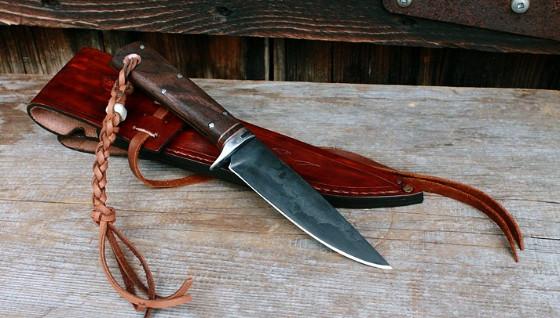 Handmade dropped point knife with its custom hooded sheath