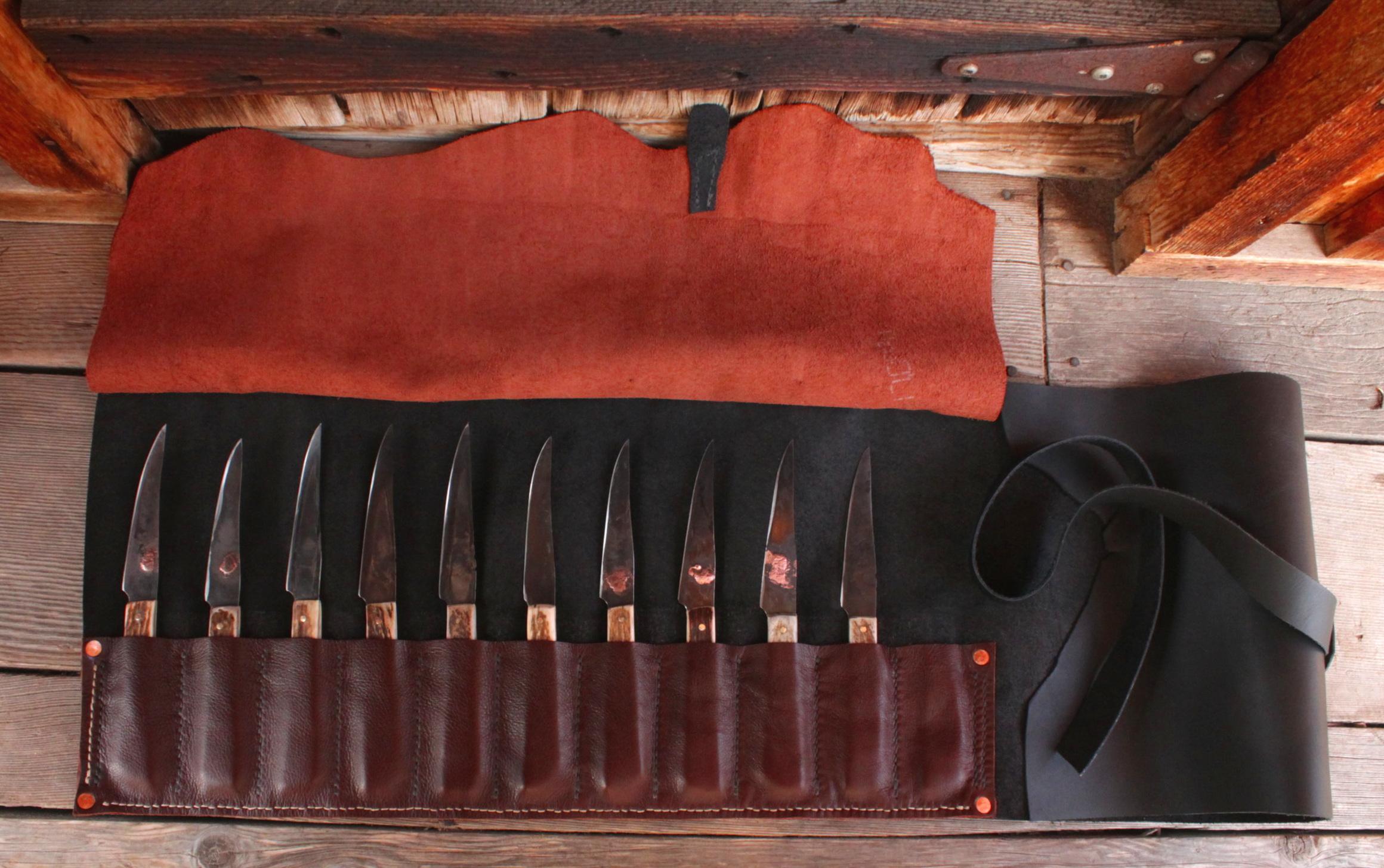 Set of handmade steak knives. Ten knives in their custom leather roll.