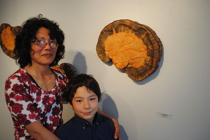 """Aki Yamamoto's solo show of carving reliefs and wood block prints, """" A Forest Falls """"."""