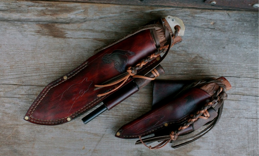 Custom made bushcraft knives with hand tooled sheaths. Both equipped with fire steels.The Woodland Rider hangs at 30 degrees and is secured with locking lanyards.