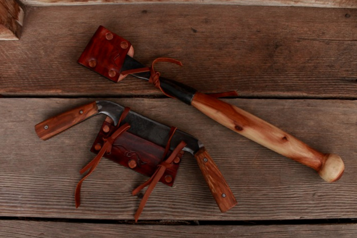 Handmade custom woodworking tools sheathed.