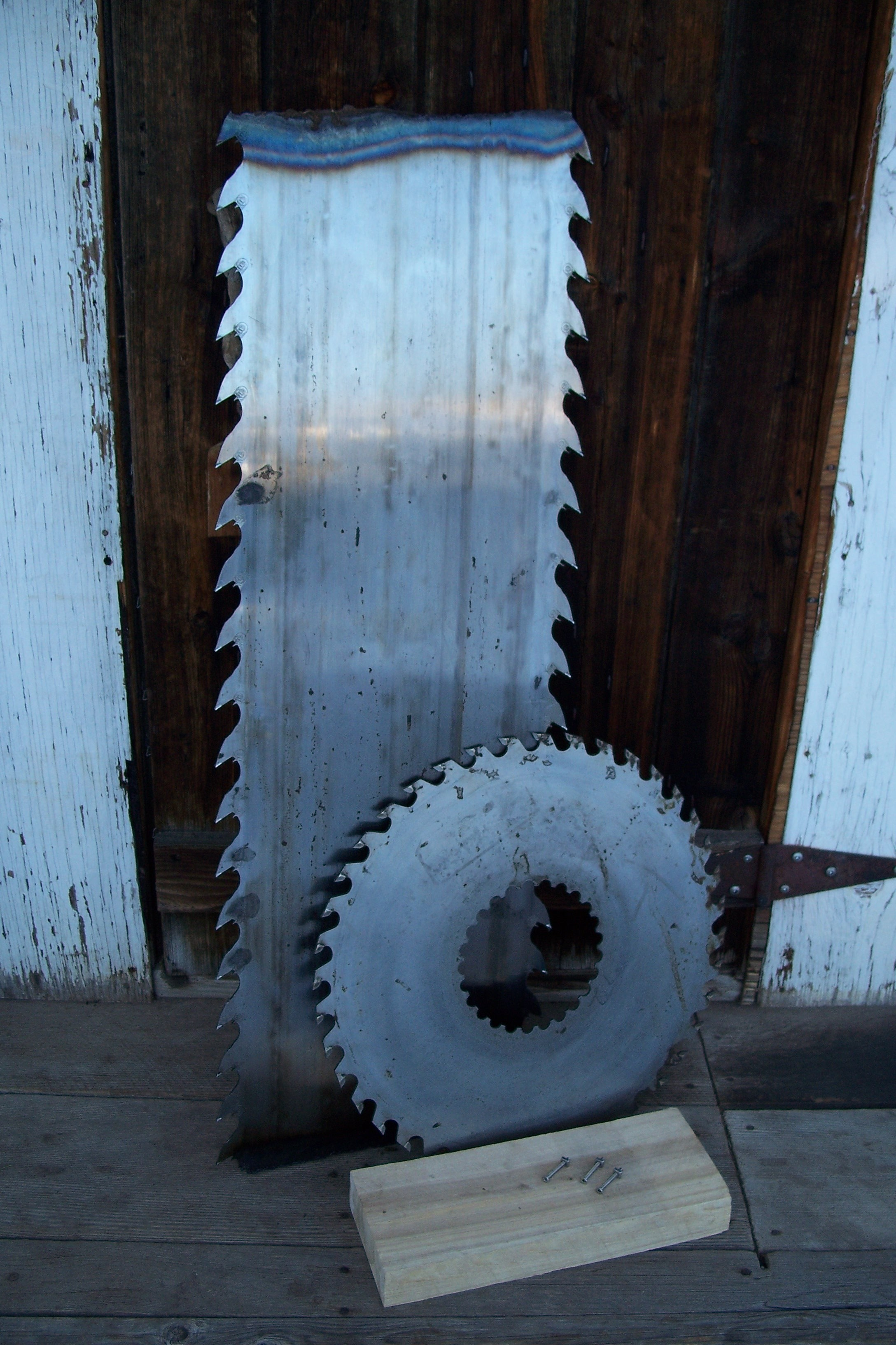 Recovered band saw blade and gang saw from lumber mills in British Columbia.
