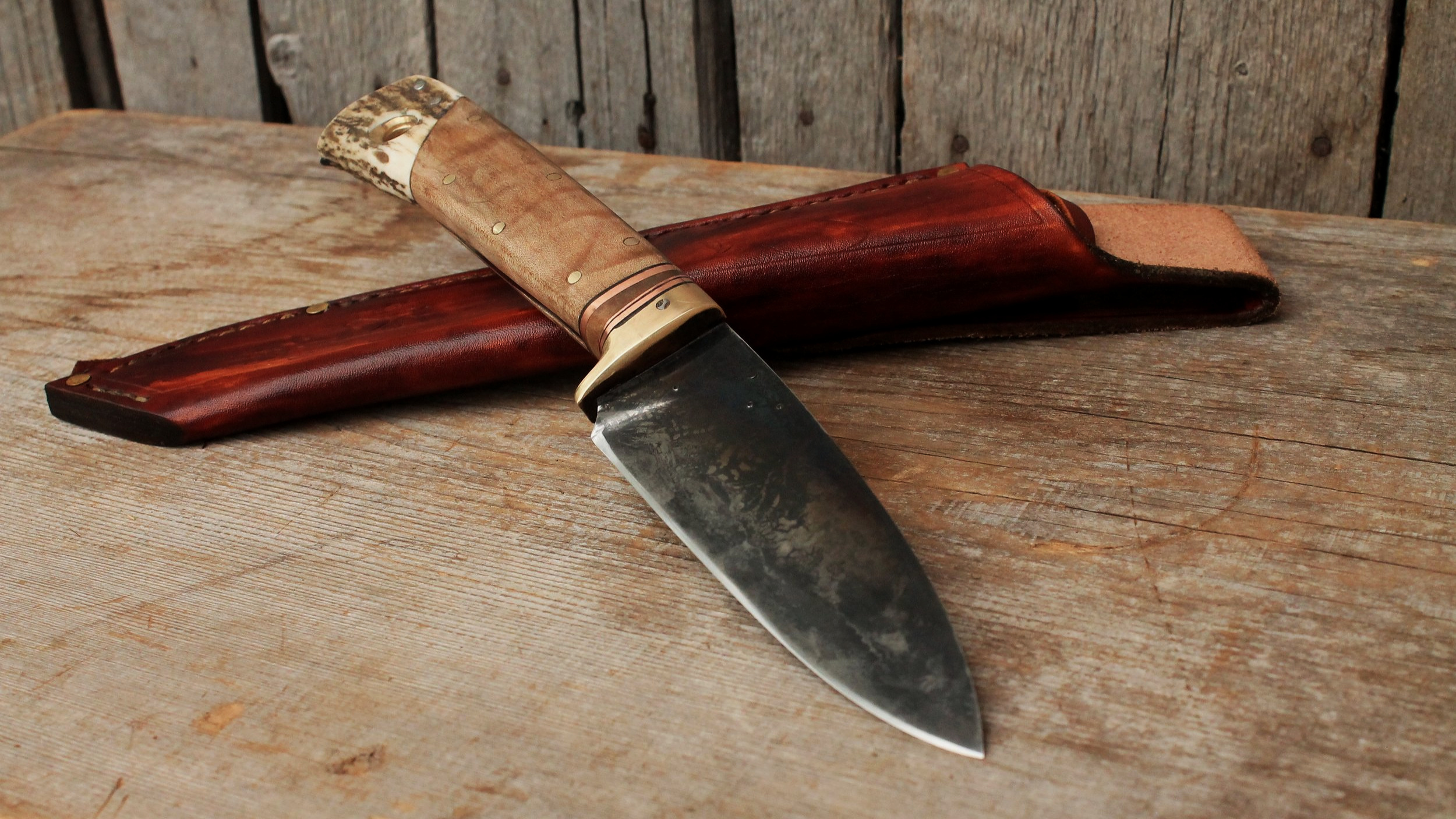 Custom hand forged hunting knife. Long handle, thick spine, high carbon lumber mill saw blade steel. A tough, strong handmade knife.